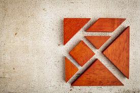 stock photo of tangram  - seven tangram wooden pieces - JPG