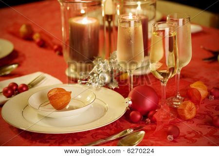 Elegant Christmas Table Setting In Red And Gold Colors