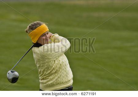 Female Collegiate Golfer Swinging Driver