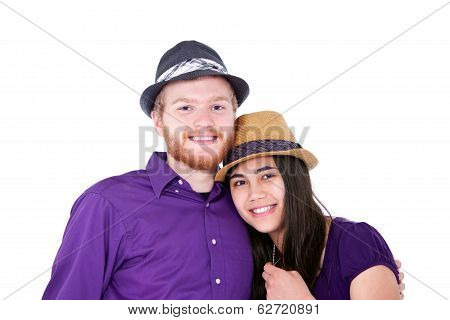 Happy Young Interracial Couple In Purple Shirts, Studio Shot
