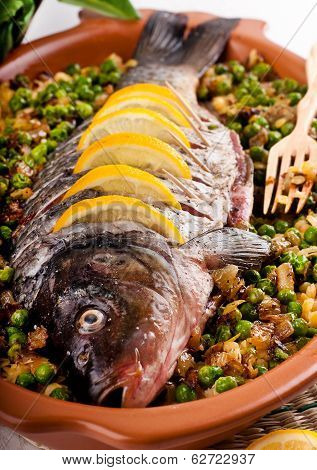 Baked crucian on a pillow from lentil and peas