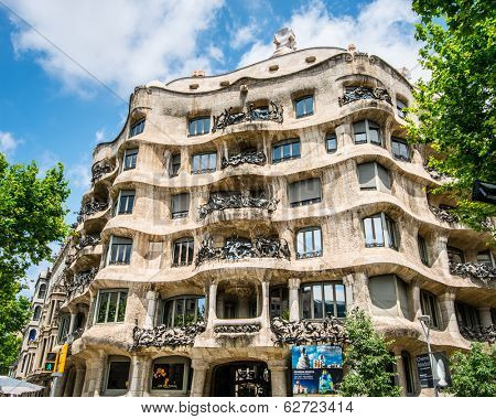BARCELONA, SPAIN - JUNE 03: Casa Mila, known as La Pedrera, on June 03, 2013 in Barcelona, Spain. This famous building was designed by the Catalan architect Antoni Gaudi.