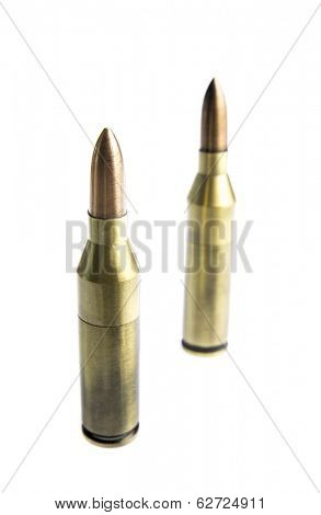 Rifle bullets on white with shallow depth of field