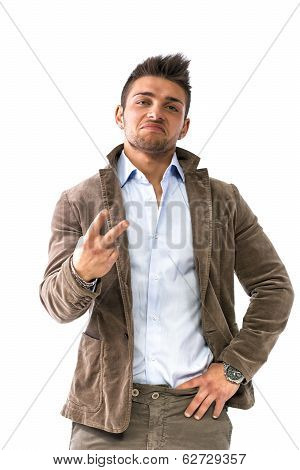 Handsome Young Man Doing 'screw You' Sign With Two Fingers