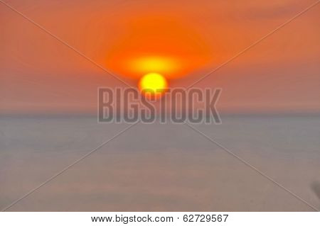 An intentionally blurry image of an orange Sun setting in Cuba