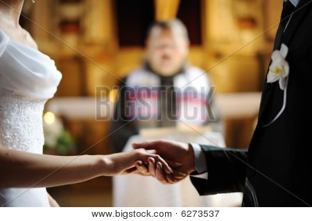 Bride And Groom Holding Each Other's Hands