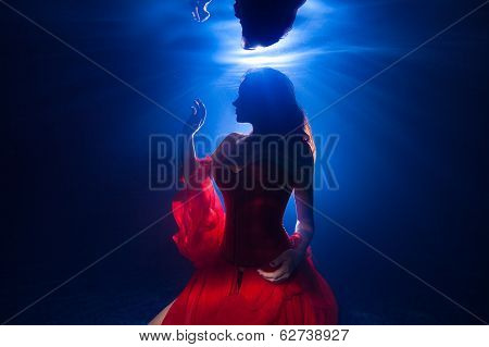 Underwater Photo Pretty Young Girl  With Dark Long Hair Wearing Red Dress