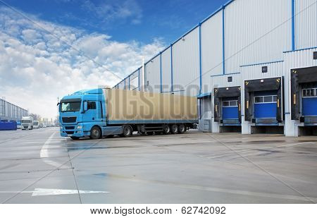Unloading Cargo Truck At Warehouse Building