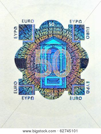 Hologram from fifty euro banknote. Macro photo.