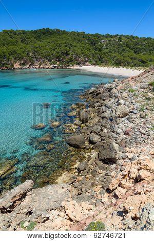 Platja des Bot beach at Algaiarens cove in sunny day, Menorca island, Spain