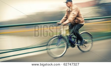 Abstract Image Of Cyclist On The City Roadway