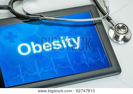 Tablet with the diagnosis obesity on the display