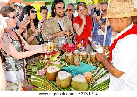 A group of reporters waiting for their coconut drink