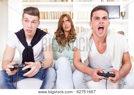 Bored Women Between Two Men With Joystick