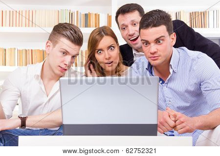 Pissed Off Casual Group Of Friends Because Results Looking On Laptop