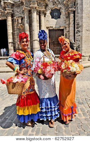 Three Cuban women in traditional dresses in Havana