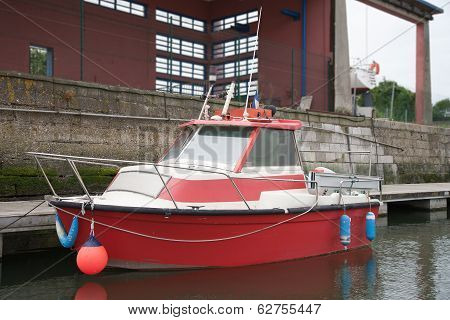 Floating Small Red Motorboat At The Dock