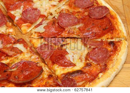 Stone-baked pepperoni pizza cut into slices.