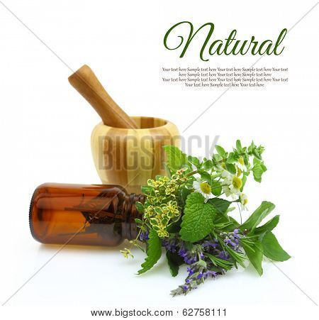Mortar and pestle with fresh herbs and medical bottle