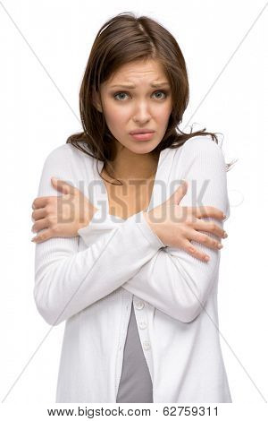 Half-length portrait of trembling female, isolated on white. Concept of cold and chill
