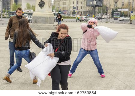 Women Fighting With Pillows