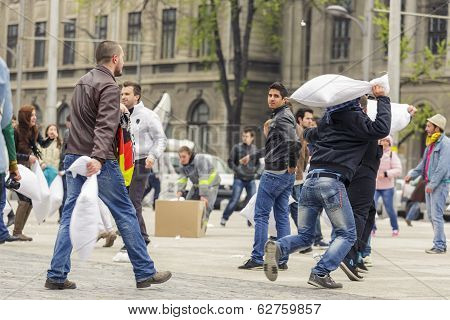 Men Fighting With Pillows
