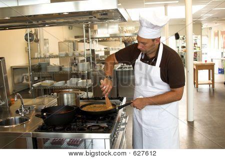 Stirring The Pasta Sauce