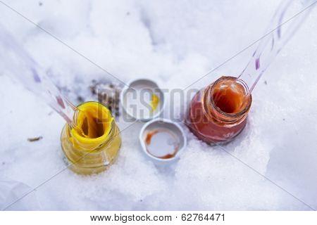 Small jars of ketchup and mustard