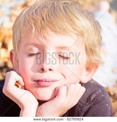 Boy Enjoying Autumn Fun
