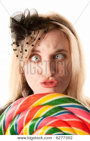 Pretty Young Woman With Lollipop