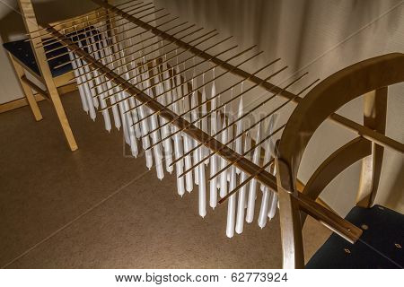 Candles On A Rack Between Chairs