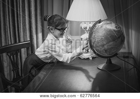 Portrait Of Girl Studying Earth Globe