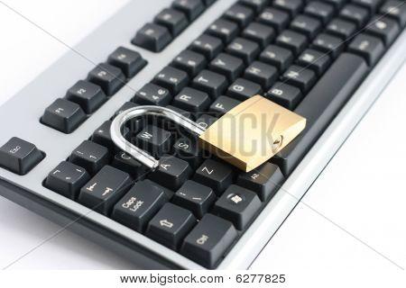 Unlocked Open Padlock And Keyboard