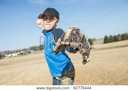 Boy pitching a baseball