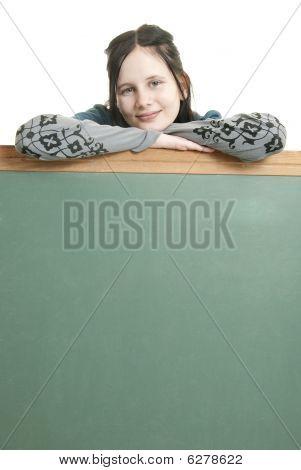 Cute Teen With Blank Chalkboard