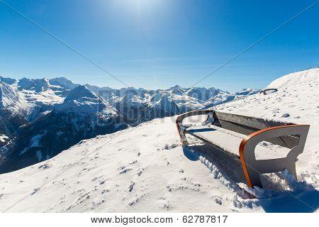 Bench In Ski Resort  In Winter Snowy Mountains, Austria, Land Salzburg,  Austrian Alps -