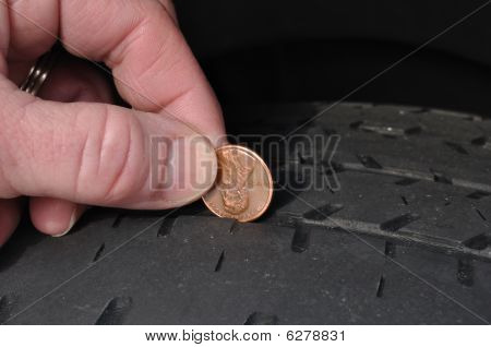 Inspecting Tire Tread Uisng A Penny