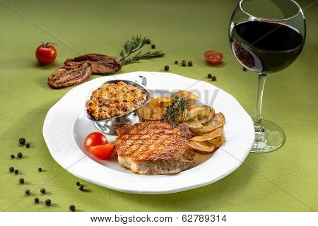 Escalope Of Pork With Potato Chips On The Green Background