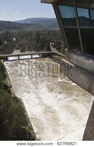 Expulsion of water after heavy rains in the reservoir of Puente Nuevo to river Guadiato near Cordoba