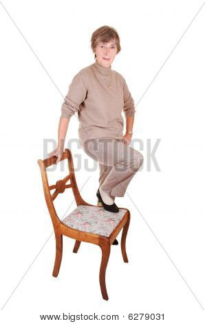 Lady Standing On Chair.