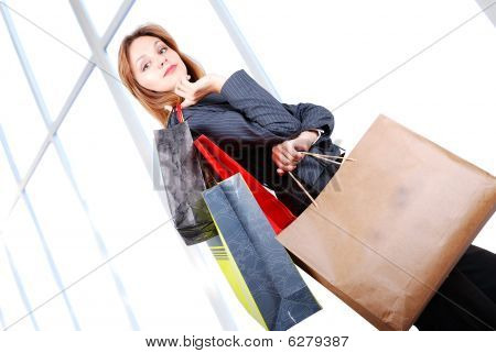 Beautiful young woman in shopping