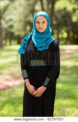 pretty middle eastern woman standing outdoors