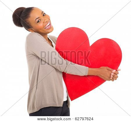 laughing afro american girl holding paper heart shape on white background