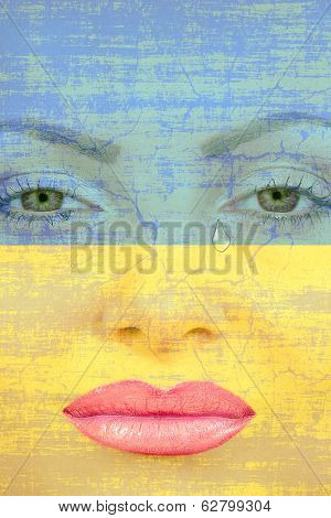 Pretty Womans Face With Tear On Ukranian Flag Background.