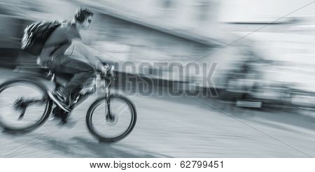 Young Man Riding A Bicycle On The Street
