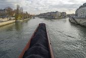 image of coal barge  - Barge loaded with coal at the Ile de la Cit�. Paris France..