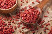 picture of tibetan  - Goji berries in a wooden spoon - JPG