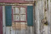 picture of yesteryear  - An abstract collage of a window with shutters created on a weathered fence as d - JPG