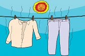 stock photo of wet pants  - Damp clothes on clothesline drying under smiling sun - JPG