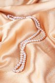 picture of mother-of-pearl  - Beautiful pearls on golden silk cloth - JPG